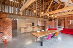 The original brick walls and high timber-trussed ceiling are left exposed inside this former barn in Suffolk, converted by David Nossiter Architects. Mini Clubman, Homes England, Shelf Furniture, Loft, Timber Cladding, Piece A Vivre, Clever Design, Architecture, White Walls