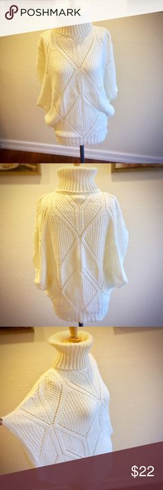 Stradivarius cocoon-shaped turtleneck sweater Purchased in Europe (Stradivarius is a European brand).  This is a eggshell white, chunky knit, cocoon-shaped sweater in medium.  Made to fit loosely with a universally flattering shape.  There may be a loose thread or two, but it's pretty inconsequential--this is a lovely winter top to wear on its own with a tank underneath or with a long-sleeved shirt to layer.  Acrylic material. Smoke-free/pet-friendly home. Stradivarius Sweaters Cowl…