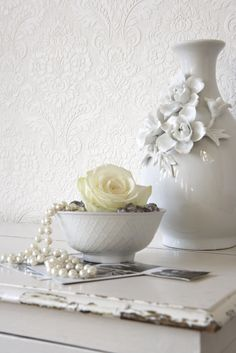 one ivory rose carefully displayed makes an elegant addition to any bedroom