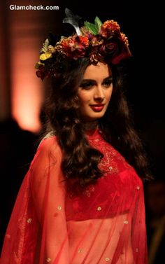 Bollywood actress Evelyn Sharma was a vision on the ramp as she displayed a creation by designers Falguni and Shane Peacock as part of the Aamby Valley India Bridal Fashion Week (IBFW) 2013 in Mumbai, India on December Bollywood Celebrities, Bollywood Actress, Floral Lehenga, Bridal Fashion Week, Indian Models, Flowers In Hair, Mumbai, Flower Hairstyles, Peacock