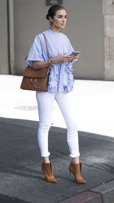 10 ways to style white denim this summer: Olivia Culpo wears white jeans, a light blue top and cognac heels and a Chloe bag