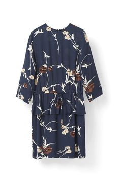 info for 12c8b a3a7e Cut from fluid printed crepe, this mini length dress has cropped sleeves, a  peplum
