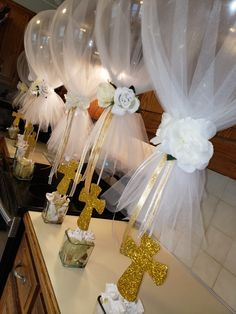 Baptism or first communion centerpieces Girl Baptism Centerpieces, Baptism Party Decorations, Communion Centerpieces, First Communion Decorations, Balloon Decorations, Frozen Centerpieces, Gold Centerpieces, Quinceanera Centerpieces, Shower Centerpieces