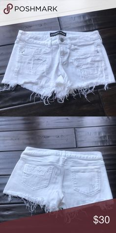 Express white denim distressed shorts Excellent condition! Smokefree home. No trades. Express Shorts Jean Shorts