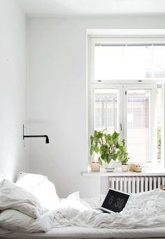 clean bright white bedroom