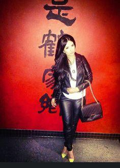 Leather pants and leather jacket and neon stiletto pumps