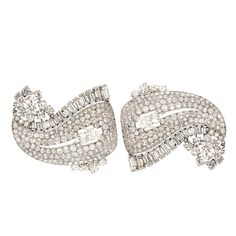 CARTIER Paisley Leaf Diamond Double Clips in platinum and gold set with round and baguettes cut diamonds weighting 20 carats approx, numbered L6098 and CO78, in the Cartier archives, dated 1941.