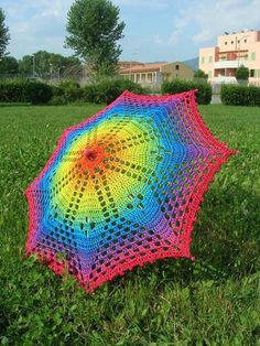 rainbow crochet umbrella -- AWESOME idea... not a pattern, but gives the general idea of how she did it