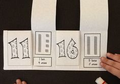 Here's a fabulous post on teaching place value in kindergarten with a number of downloads, including this place value flip book!