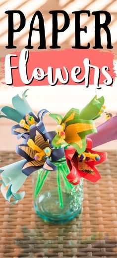 These bright and beautiful tropical paper flowers are made from scrapbook paper and card stock. I was inspired by the gorgeous tropical flowers in warm weather climates. #paperflowers #paperflowertutorial #papercrafts #paperlilies #tutorial #craftsbyamanda