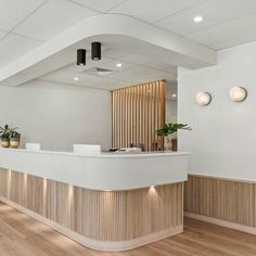 We love the use of Tas Oak dowel in this stunning eye clinic reception. Interior by Medical Office Interior, Medical Office Design, Healthcare Design, Clinic Interior Design, Clinic Design, Commercial Design, Commercial Interiors, Tanzstudio Design, Counter Design