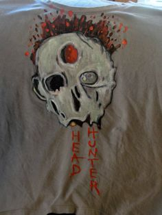 Hand painted zombie t-shirt in acrylic.  (link to how to make acrylic paint permanent on fabric on e-how)
