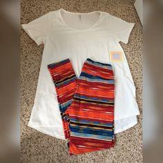 LuLaRoe Leggings & Classic T Set NWT OS leggings and Classic T. Only tried each item on once. ✨Bundle & save!✨ LuLaRoe Pants Leggings