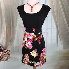 "Be Bop Black Floral Dress Today, featuring in Kaki Jo's closet is the cute little black floral dress.  Great condition. Size M. Bust 30 and length 33"".  Note: necklace not included.  DR189 BeBop Dresses"