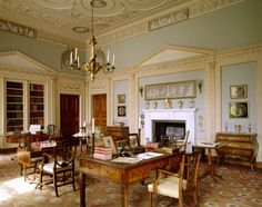 A view across the Library at Berrington Hall, Herefordshire, with the 'Chippendale' writing desk set with books