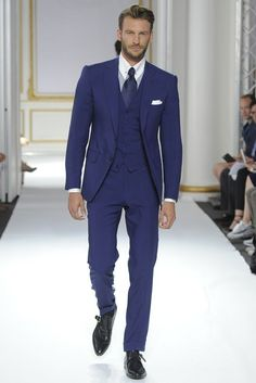 Team a dark blue three piece suit with a white oxford shirt for a sharp, fashionable look. Black leather monks will give your look an on-trend feel.   Shop this look on Lookastic: https://lookastic.com/men/looks/three-piece-suit-dress-shirt-monks/21103   — White Dress Shirt  — Navy Tie  — White Pocket Square  — Navy Three Piece Suit  — Black Leather Monks