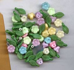 vintage flower and leaf beads pastel mixture by beadtopiavintage #embellishment #flowers
