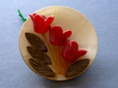 Celluloid Weeber Plate With Flowers Button