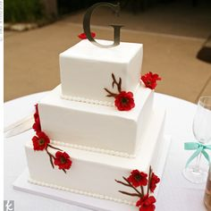 Silk cherry blossoms sprouted from the chocolate brown icing on the cake. A simple silver monogram topped the three-tiered confection