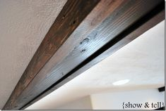 """Faux wood beams for Living and Dining rooms... 5- 4""""x12' spans...   1- 6"""" x 9' span for peak of ceiling  this tutorial uses 2x4s... could I use 1x4 and 1x6?"""