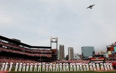 Cardinals players watch a fly over by a B-25J Mitchell on Opening Day at Busch Stadium on Monday, April 8, 2013. Photo by Robert Cohen, rcohen@post-dispatch.com
