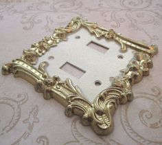 """Switch Plate 1960s light switch cover Vintage vintage 1960s two tone metal cast switch plate cover - off white with bright antique gold colours- Hollywood Regency / Cottage Chic / Paris Apartment - fabulous for your retro styled room - Size - 4.5"""" x 4.5"""" at widest points - Weight - 173gms - Circa - 1960s/70s Origin - Charm-n-Style - $16.00"""