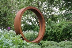 Paperbark steel ring garden sculpture for front garden near Wetherby, Yorkshire