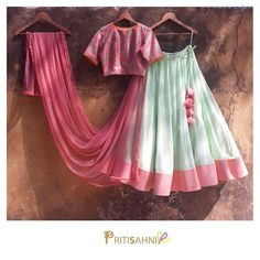 Mints and Pinks.The cool combination of mint green georgette lehenga with blush pink floral chanderi crop top with ruffled dupatta.For more information DM or Whatsapp on +91-9022617481. 25 February 2018