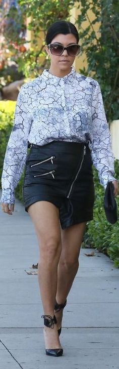 Kourtney Kardashian : Shirt and skirt – H&M  Shoes – Gucci  Sunglasses – Kardashian Kollection  Purse – Chanel