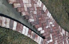 Herringbone brick path; half circle brick at the front of the steps.