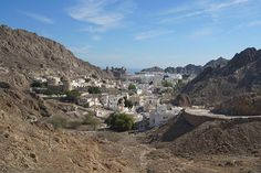 Barren mountains encircle the whitewashed buildings of Old Muscat. Image by James Kay / Lonely Planet.  #roadtrips #oman