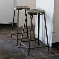 metal stool that have a 'tufted' top which ties into the interiors