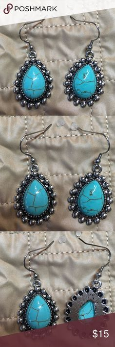 "Pierced Earrings  turquoise and silver tone. Pierced Earrings  turquoise and silver tone.    Approximately 1"" long x 1"" wide.  Never been worn.  Great earrings. Jewelry Earrings"