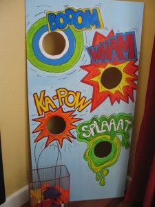 beanbagtoss: Superhero party    The bean bag toss game idea. Use thin fiberboard and cut out the holes with a jigsaw.Paint on the fun sound effect words. Super Fun to play since each time a kiddo gets a bean bag through the hole they shout out the sound effect.