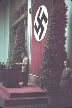 """Hitler speaks at Munich's Haus der Kunst during the 1939 """"Day of German Art. Ww2 Pictures, Ww2 Photos, Nazi Propaganda, The Third Reich, Fantastic Art, Military History, Color Photography, World War Two, Historical Photos"""