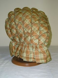Wadded silk bonnet for winter. Etsy. Plain tan polished cotton lining.