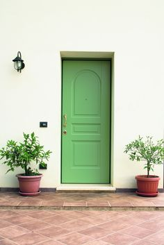 Light green Evolution door by Oikos Venezia with upper arched molding.  www.oikos.it