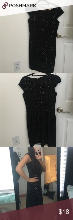 Black dress - great quality! Size 4 Size 4 black dress with cream/tan colored lining that peaks through as accents. Great quality and great condition. Never worn. There are slight cap sleeves and the length comes down to just above my knees. I'm almost 5'2, 118 lbs. it's fits well on me, not too tight but not too loose. There is still room to breathe and move. Great as professional clothing, for a wedding, or even church, and looks great with a necklace and some heels. Fits like a small to…