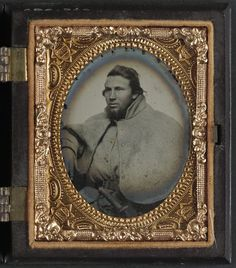 Unidentified soldier in 1st Virginia cavalry with a great coat. Between 1861 and 1865