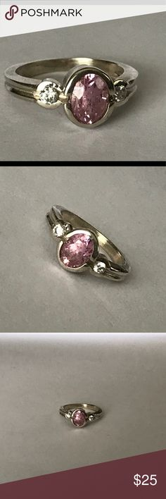 Pink Ring Set in sterling silver. Oval shaped pink cz and is adorned by clear cz's on each side. It is hallmarked 925 Vintage Jewelry Rings