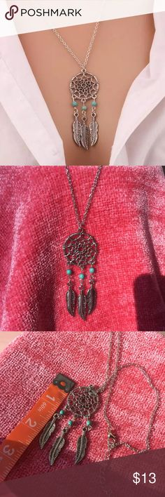"""Silver Dreamcatcher Necklace Pretty silver toned Dreamcatcher Necklace. Turquoise Beads. Chain is about 19"""" plus 2"""" extender. New in package. Jewelry Necklaces"""