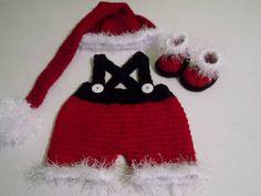 Conjunto confeccionado em crochê - composto: shorts com suspensorio,gorro e botas detalhes - botões cor- vermelho, branco e preto tamanhos - 0 a 3 / 3 a 6 / 6 a 9 / 9 a 12 meses frete por conta do comprador R$ 99,00