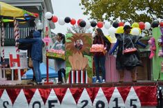 Members of the senior class of 2015 on their float in the Herndon Homecoming Parade held in downtown Herndon. The class of 2015…