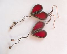 Hey, I found this really awesome Etsy listing at http://www.etsy.com/listing/75252456/heart-earrings-stained-glass-copper-wire