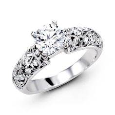 This gorgeous 18K white engagement ring is comprised of .50ctw round white Diamonds.