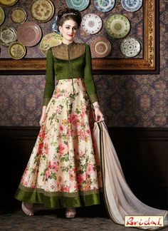 Be the sunshine of everyone's eyes dressed in this green silk anarkali salwar kameez. The wonderful dress creates a dramatic canvas with astounding patch border and print work. Comes with matching b...