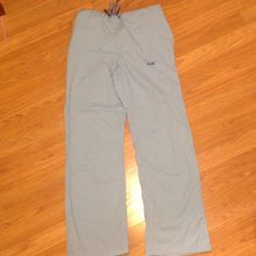 Iguana scrub pants A pair of Iguana scrub pants in great condition. Light blue in color only worn twice. From smoke free home. Iguana Pants