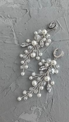 wedding hair videos Bridal long branch earrings with pearls and cubic zirconia crystals, Wedding pearl earrings, twig earrings / Buy on Etsy / ED Accessory / Ready to ship! Jewelry Tags, Art Deco Jewelry, Jewelry Design, Crystal Jewelry, Silver Jewelry, Antique Jewelry, Vintage Jewelry, Grandmother Jewelry, Gemstone Colors