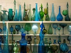 I have a weird love of old glass, especially colored glass. I rubber-neck at antique stores because they usually have glass vases, compotes, bottles, etc in the front windows.
