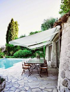 love the stone patio and roll-away awning....